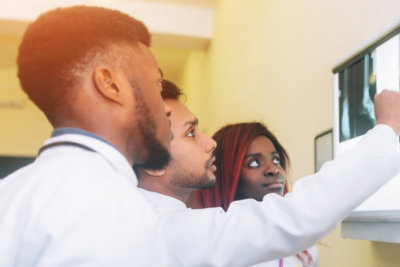 three people looking at the x-ray