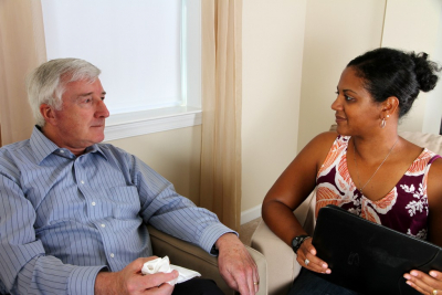 senior man in counseling session with woman